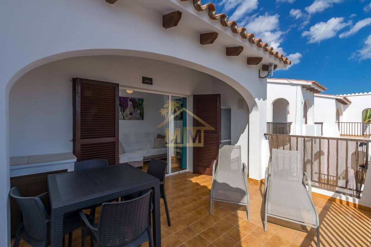 Calan Porter   apartment with communal Tourist Licence and pool
