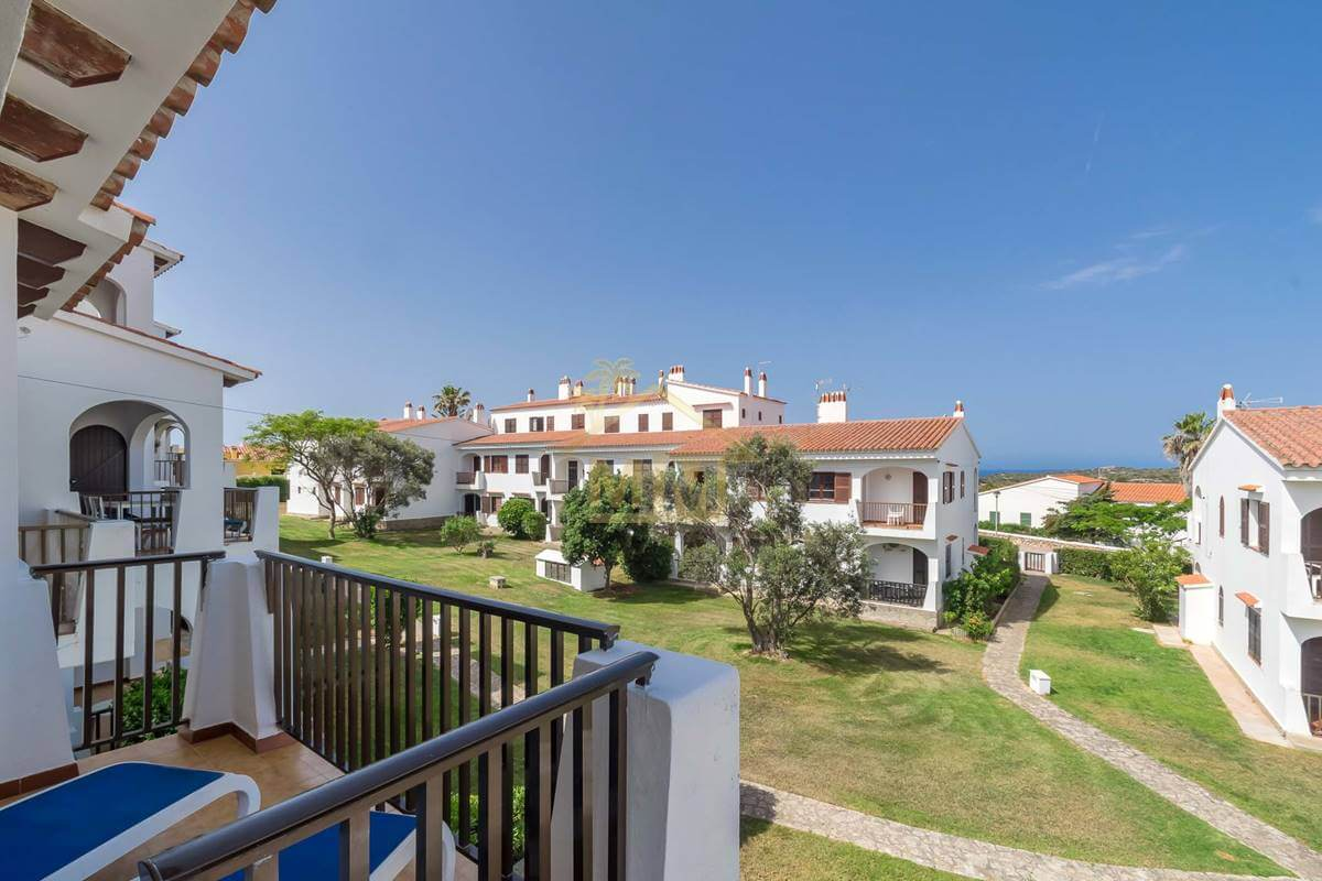 Calan Porter | First floor apartment with communal pool and Tourist License