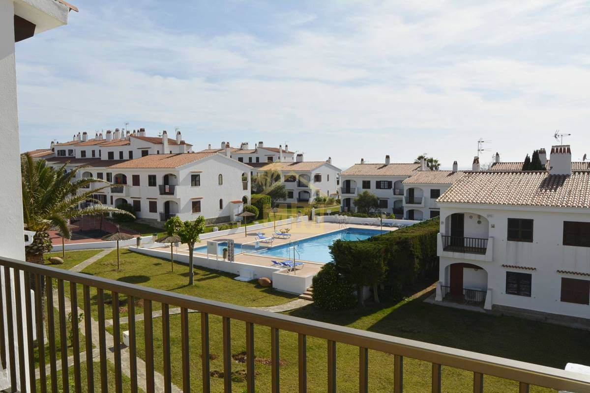 Calan Porter | apartment with communal Tourist Licence and pool